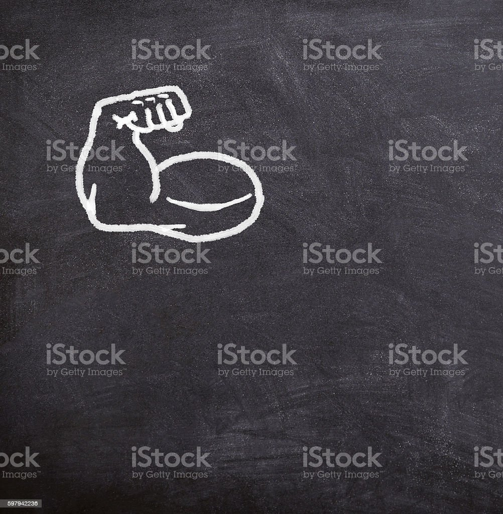 fake muscles drawn on the blackboard foto royalty-free