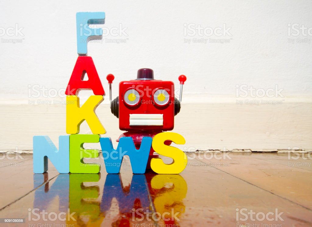 fake news and retro robot head stock photo