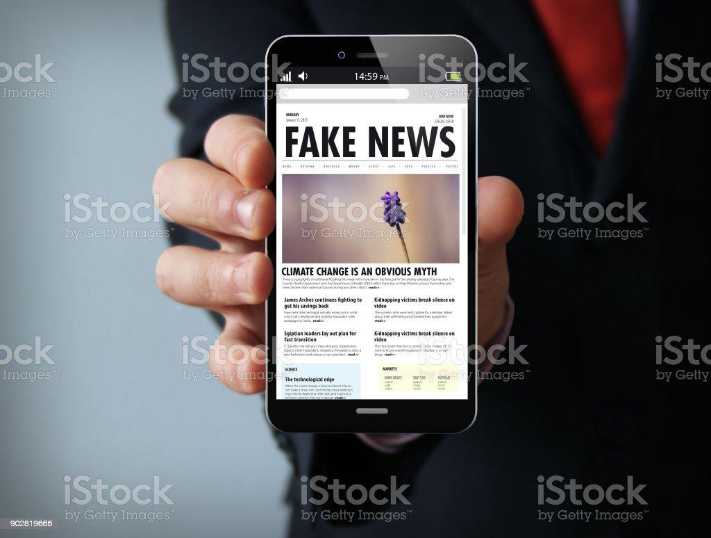 fake news businessman smartphone stock photo