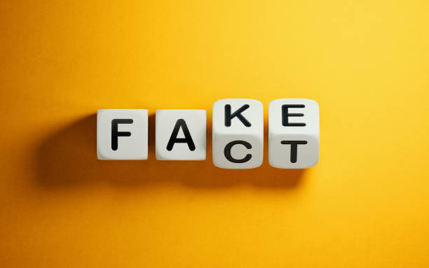 Fake News Concept White block are rotating on yellow background.  Fake and fact writes on the cubes. Fake news concept. Horizontal composition with copy space. dishonesty stock pictures, royalty-free photos & images