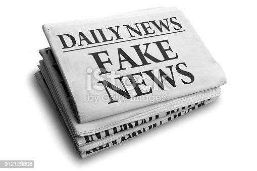 Daily news newspaper headline reading fake news concept for false event news headline