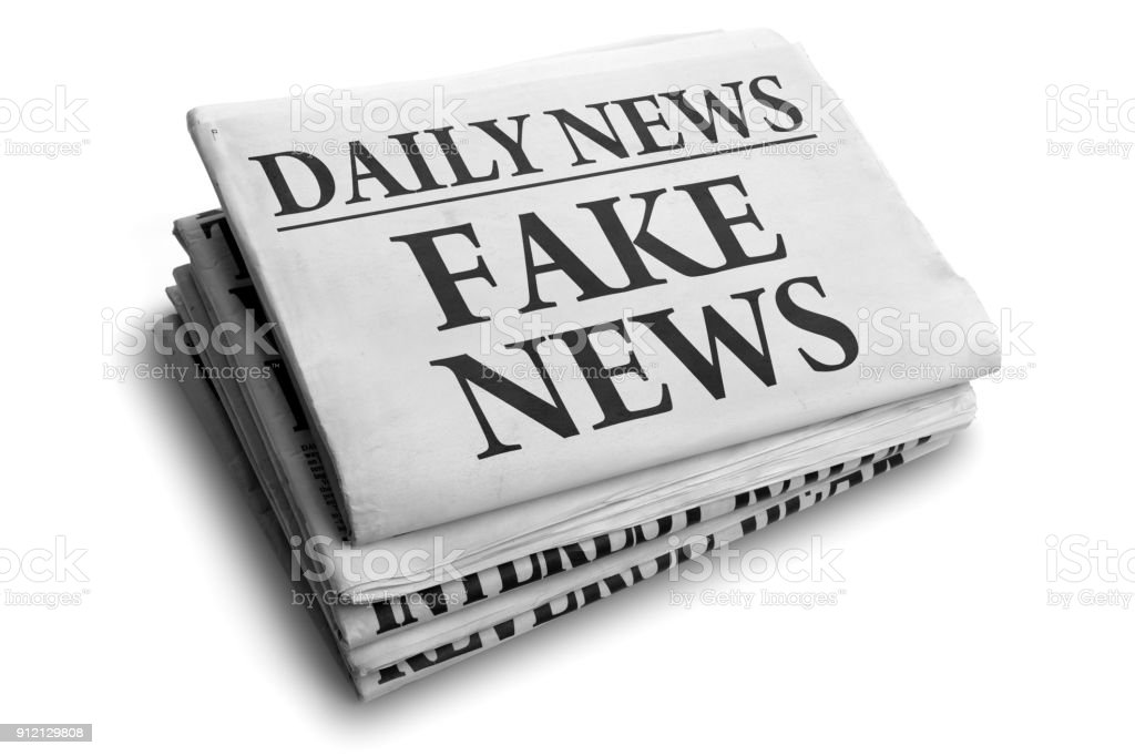Fake news daily newspaper headline stock photo
