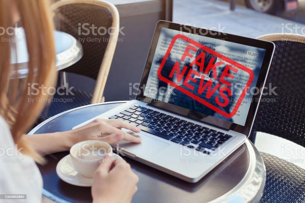 fake news on internet stock photo