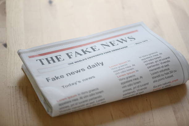 fake news paper on table fake news paper on table front page stock pictures, royalty-free photos & images