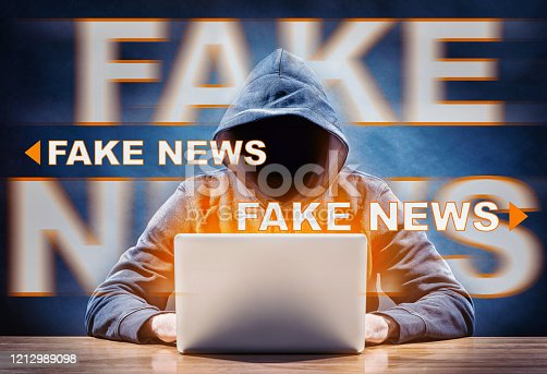 a hacker spreading fake news from a computer