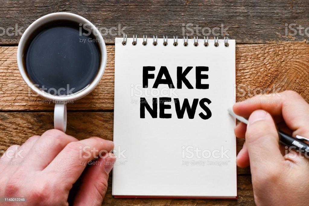Fake news text concept stock photo