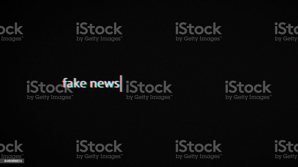 fake news text laptop screen stock photo
