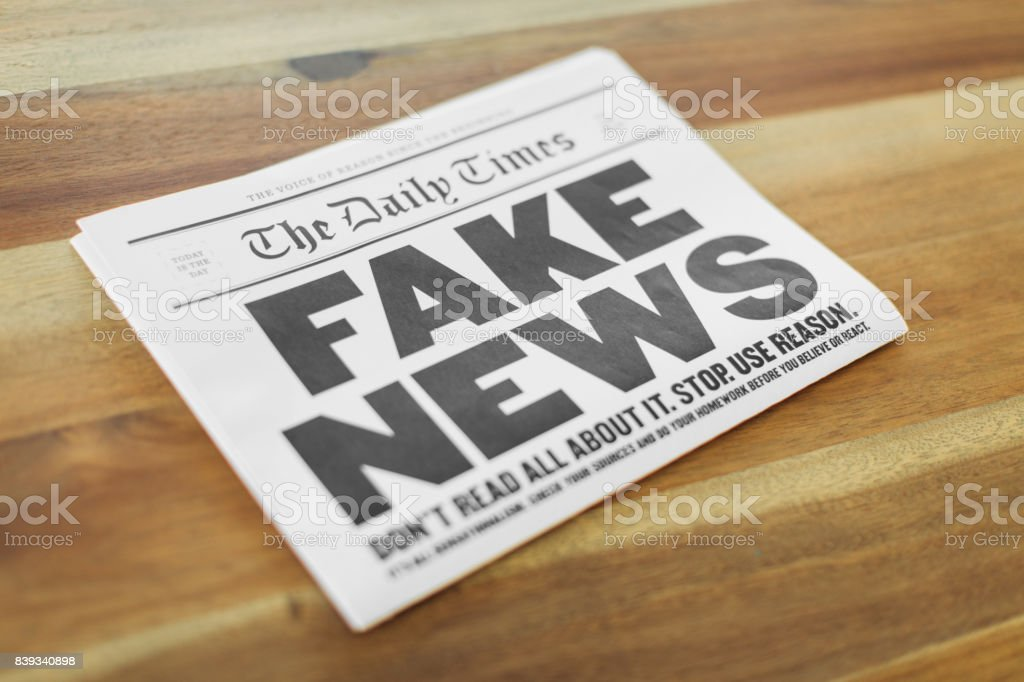 Fake Newspaper on Kitchen Table stock photo