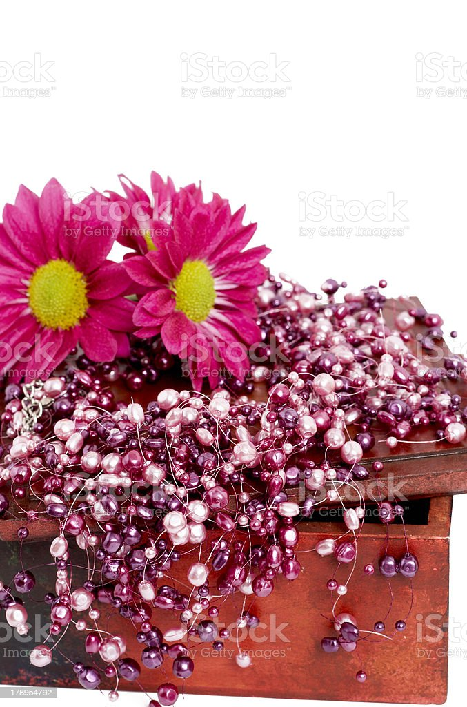 Fake pink pearls with flowers royalty-free stock photo