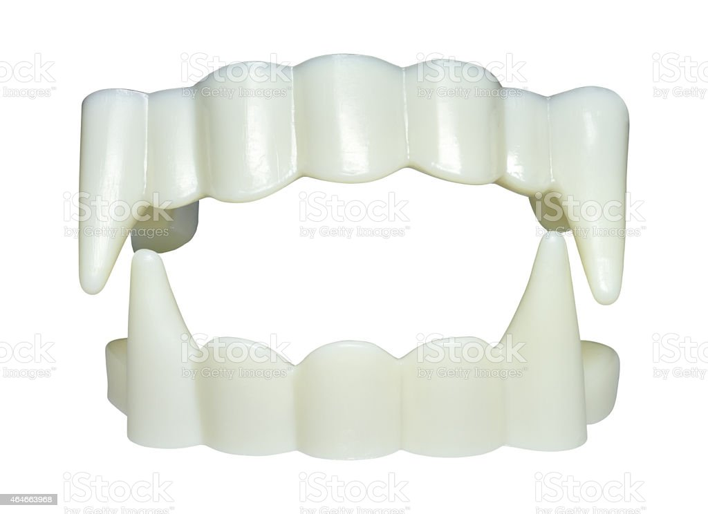 Fake plastic vampire teeth for Halloween stock photo