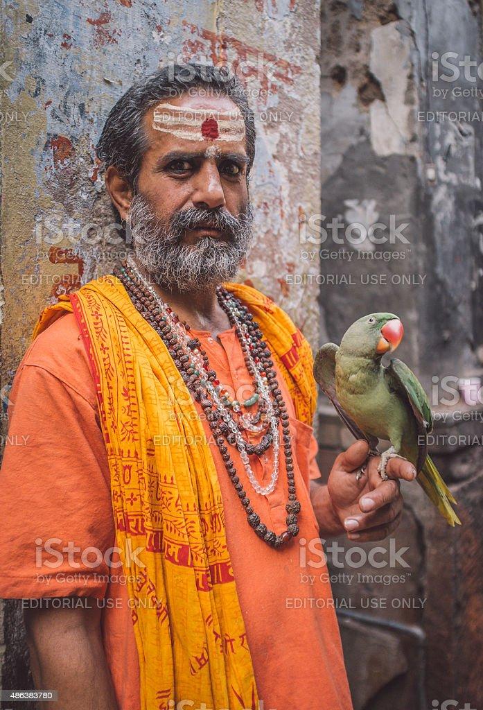 Fake sadhu with parrot stock photo