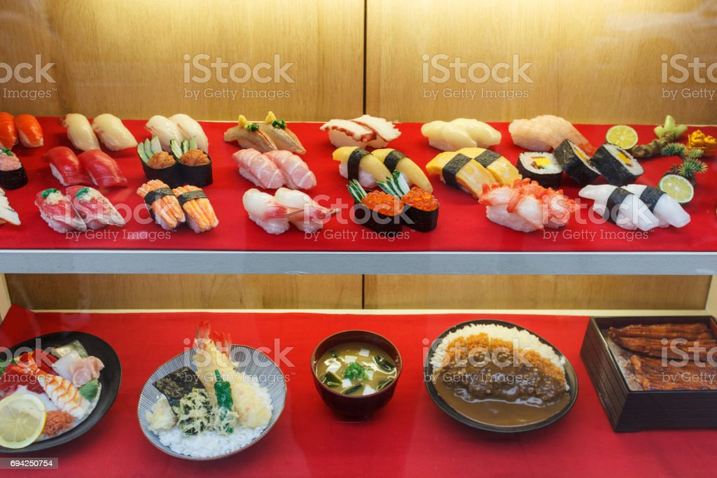 fake sushi in display window - plastic food stock photo