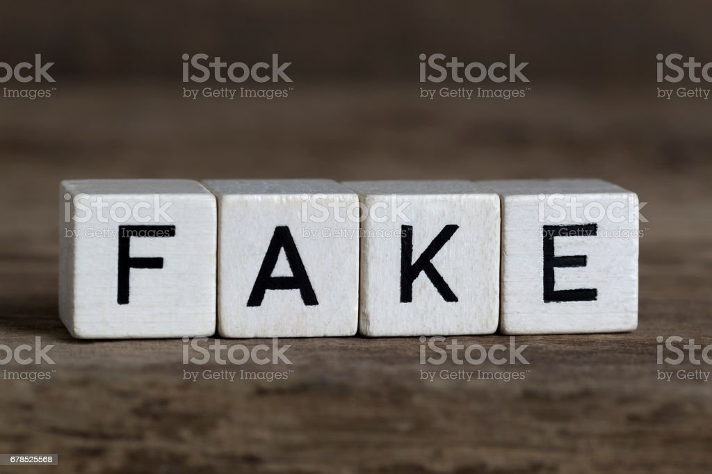 Fake, written in cubes stock photo