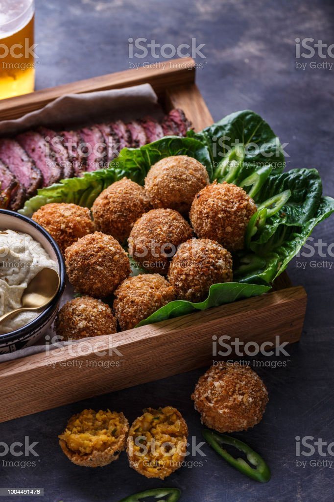 Falafel balls on a romano leafs in a wooden box stock photo