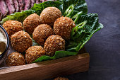 istock Falafel balls on a romano leafs in a wooden box 1179124895