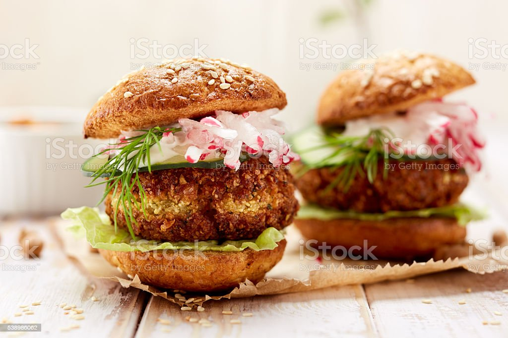 Falafel burger on a wooden rustic table stock photo