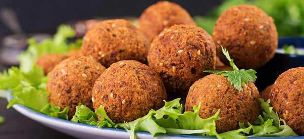 istock Falafel, hummus and pita. Middle eastern or arabic dishes on a dark background. Halal food. Banner 1139182817