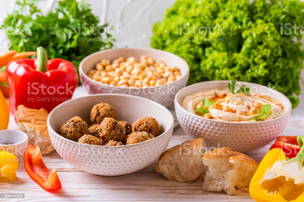 Falafel, pita, hummus and chickpea  with vegetables. horizontal view stock photo