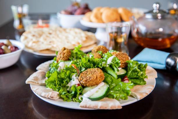Falafel served on top of salad stock photo