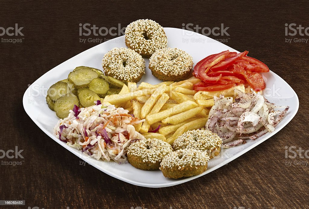 Falafel with french fries and vegetables royalty-free stock photo