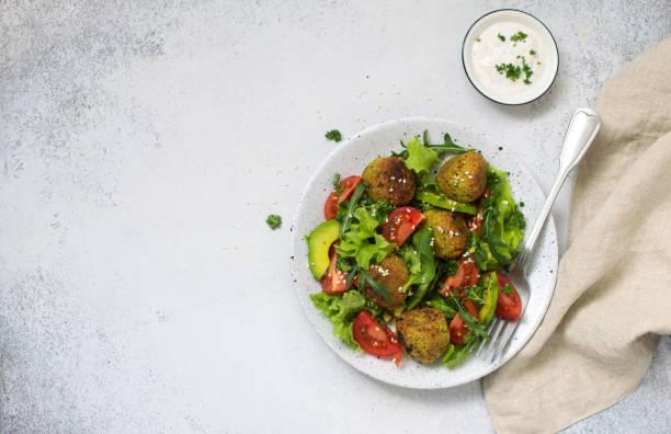 Falafel with fresh vegetable salad stock photo