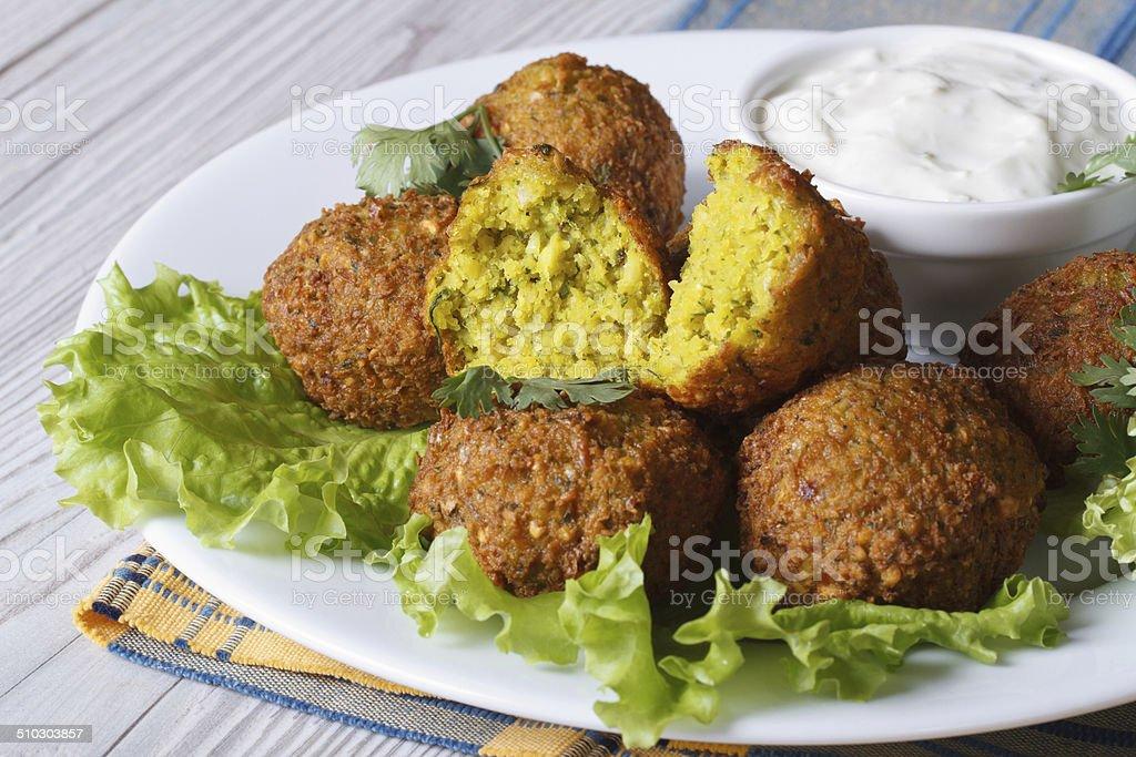 falafel with lettuce and tzatziki sauce closeup horizontal stock photo