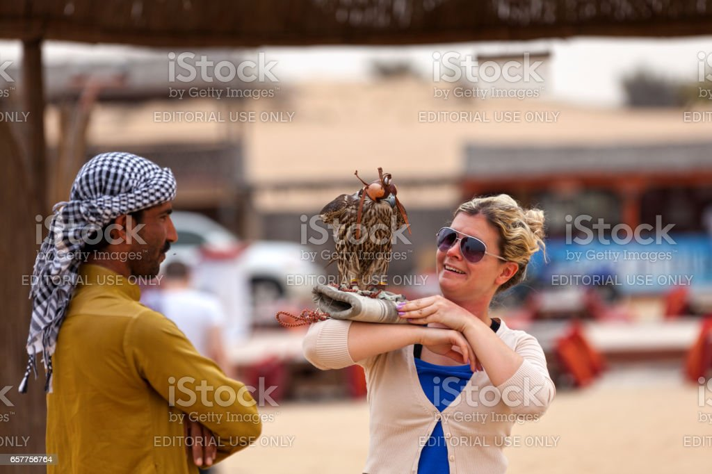 Falconer in the Liwa desert stock photo