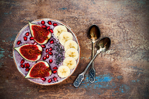 Fall and winter breakfast acai superfoods smoothies bowl. Copy space stock photo
