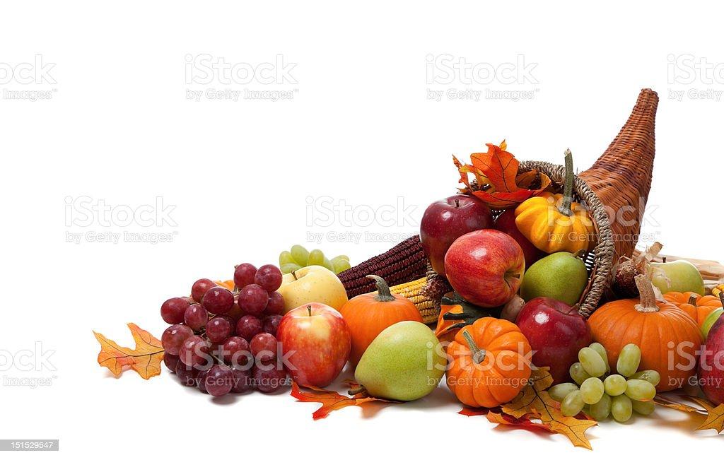 Fall, autumn or harvest cornucopia on a White back ground royalty-free stock photo