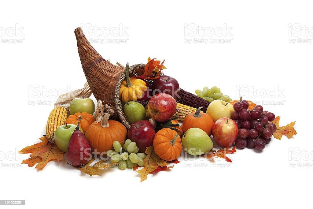 Fall, autumn or harvest cornucopia on a White back ground A Fall, autumn or harvest cornucopia on a White back ground.  INcludes grapes, pumpkins, apples gords and leaves. Horn of plenty Abundance Stock Photo