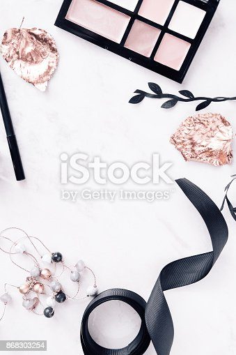 istock Fall beauty products flatlay on white marble 868303254