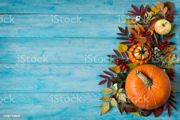Fall border of apples berries pumpkins on blue table copy space picture id1058743642?b=1&k=6&m=1058743642&s=612x612&h=hpysrirhiu8mectgmxrrw dpf7l  rqm5gvj8w6o894=