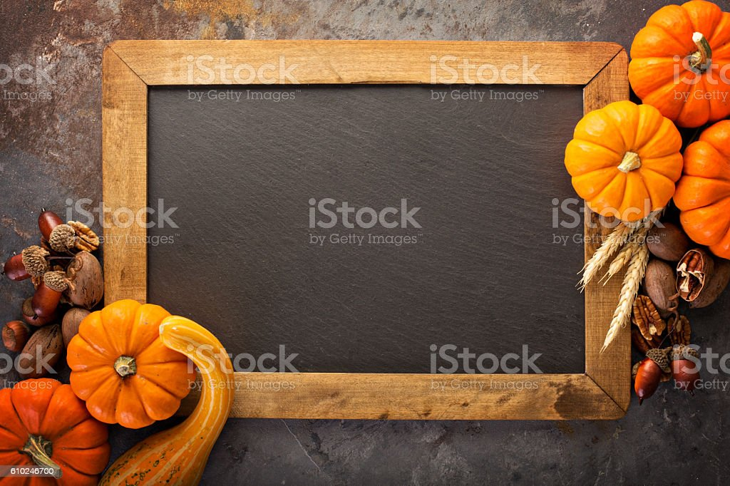 Fall chalkboard frame with pumpkins stock photo