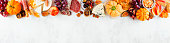 istock Fall charcuterie top border against a white marble banner background 1276818991