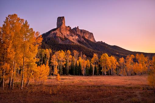 Fall colors and Aspen trees at Chimney Rock in Owl Creek Pass near Ridgeway, Colorado.