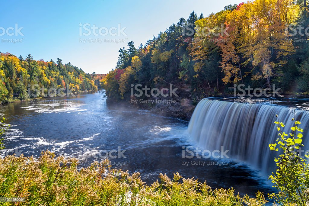 Fall colors at Tahquamenon Falls stock photo