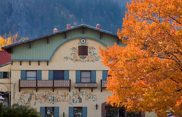 fall colors german buildings orange maple leaves leavenworth washington - leavenworth washington stock photos and pictures