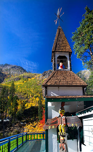 fall colors german store steeple outside leavenworth washington - leavenworth washington stock photos and pictures