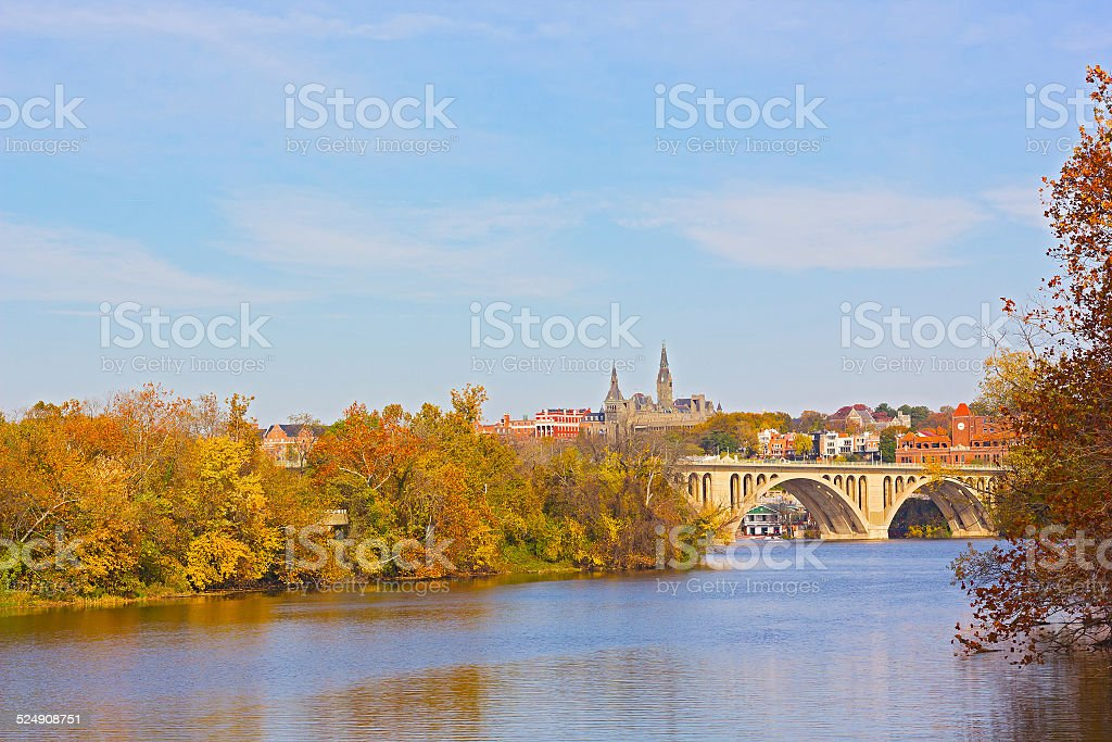 Fall colors of Potomac riverside and Key Bridge, Washington DC. stock photo