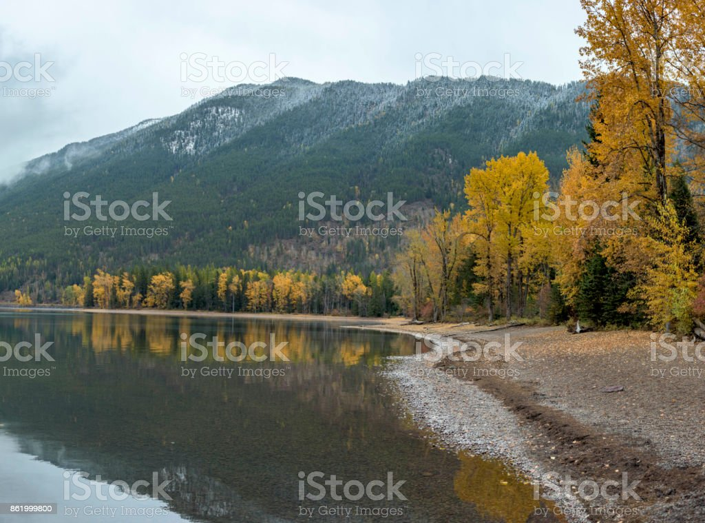 Fall colors on the shoreline of Lake McDonald in Glacier National Park. stock photo