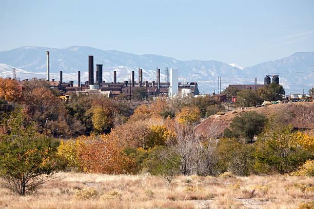 Fall colors with Pueblo's Colorado Steel Mill smoke stacks horizontal stock photo