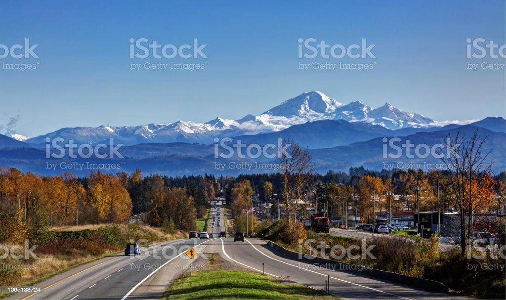 Fall colours on sides of road to Mt. Baker stock photo