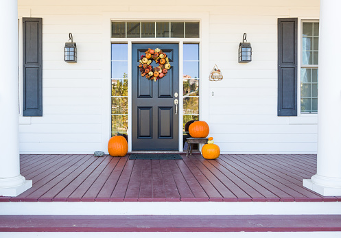 Fall Decoration Adorns Beautiful Entry Way To Home.