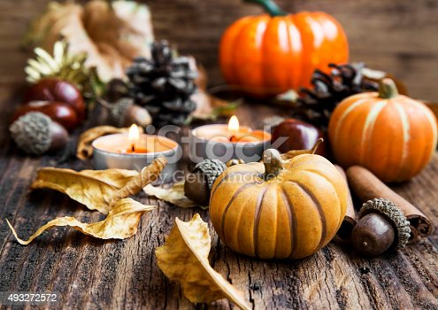 istock Fall Decoration.Pumpkins,Orange Candles,Cinnamon,Chestnuts and 493272572