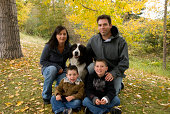 A family of four with their dog.