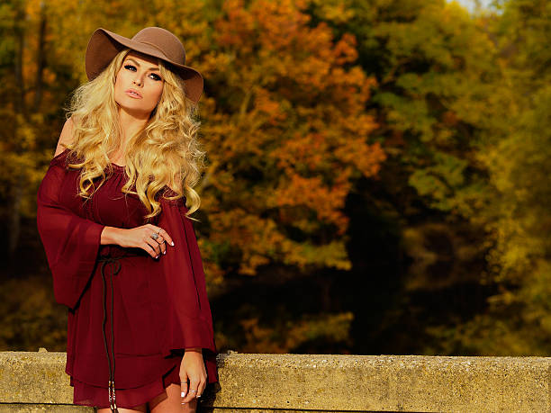 Fall Fashion Blonde Curly Hair Model With Hat stock photo