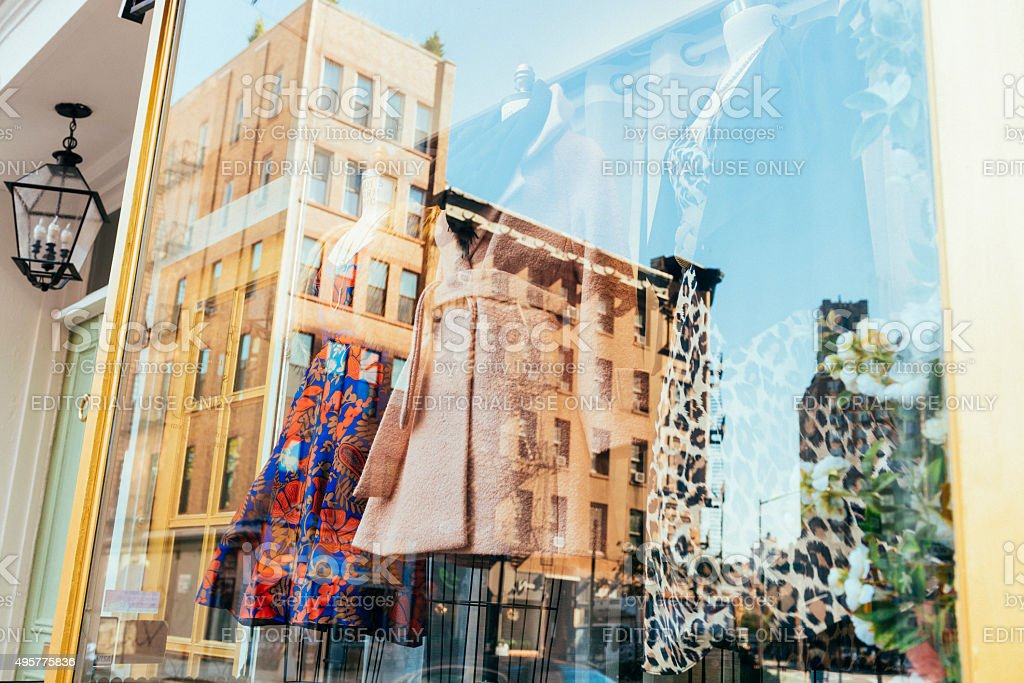 NYC Fall Fashion Retail Business Window Display Reflecting Urban Buildings stock photo