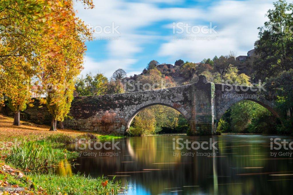 Fall foliage at river Arnoia in Allariz, Ourense stock photo