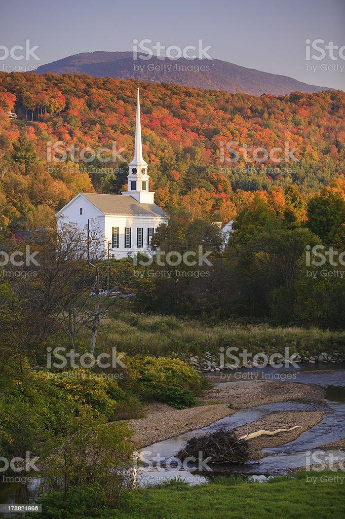 Fall foliage behind a rural Vermont church stock photo