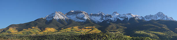 Fall Foliage Mount Sneffels Range The fall foliage of golden aspen grove stand out like gold paint on the foothills of the Sneffels Range. County road 5, Ridgway, Colorado. san juan mountains stock pictures, royalty-free photos & images